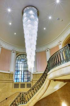The staircase leading up to the Salon Rose. The glass chandelier, meant to resemble icicles, is a nod to Quebec City's annual Winter Carnival.